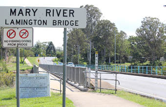 Lamington Bridge over Mary River with Signs in foreground